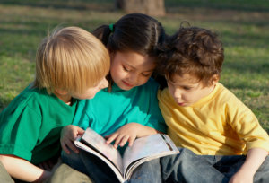 three kids reading